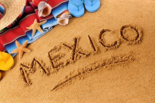 sandy beach with word Mexico etched in middle